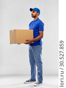 Купить «indian delivery man with parcel box in blue», фото № 30527859, снято 12 января 2019 г. (c) Syda Productions / Фотобанк Лори