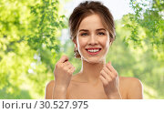 Купить «happy young woman with dental floss cleaning teeth», фото № 30527975, снято 20 января 2019 г. (c) Syda Productions / Фотобанк Лори
