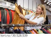 Купить «Woman choosing leather jacket», фото № 30528539, снято 5 сентября 2018 г. (c) Яков Филимонов / Фотобанк Лори