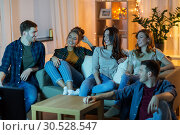 Купить «happy friends watching tv at home in evening», фото № 30528547, снято 22 декабря 2018 г. (c) Syda Productions / Фотобанк Лори