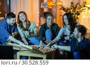 Купить «friends eating pizza and drinking wine at home», фото № 30528559, снято 22 декабря 2018 г. (c) Syda Productions / Фотобанк Лори