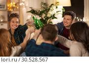 Купить «friends clinking drinks at home in evening», фото № 30528567, снято 22 декабря 2018 г. (c) Syda Productions / Фотобанк Лори