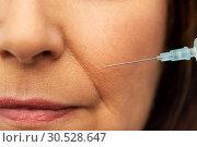 Купить «close up of senior woman face and syringe», фото № 30528647, снято 8 февраля 2019 г. (c) Syda Productions / Фотобанк Лори