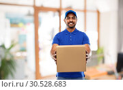 Купить «indian delivery man with parcel box at office», фото № 30528683, снято 12 января 2019 г. (c) Syda Productions / Фотобанк Лори