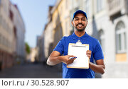 Купить «happy indian delivery man with clipboard in city», фото № 30528907, снято 12 января 2019 г. (c) Syda Productions / Фотобанк Лори