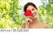 Купить «beautiful smiling woman holding red heart», фото № 30528923, снято 20 января 2019 г. (c) Syda Productions / Фотобанк Лори