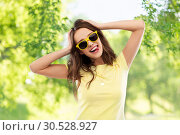 Купить «teenage girl in yellow sunglasses and t-shirt», фото № 30528927, снято 29 января 2019 г. (c) Syda Productions / Фотобанк Лори