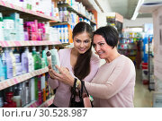 Купить «Happy women picking cream from shelf», фото № 30528987, снято 18 апреля 2019 г. (c) Яков Филимонов / Фотобанк Лори