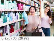 Купить «Two women choosing shampoo», фото № 30528995, снято 18 апреля 2019 г. (c) Яков Филимонов / Фотобанк Лори