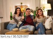 Купить «friends toasting non-alcoholic beer at home», фото № 30529007, снято 22 декабря 2018 г. (c) Syda Productions / Фотобанк Лори