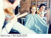 Купить «Woman decides with master how to cut hair», фото № 30529031, снято 7 марта 2017 г. (c) Яков Филимонов / Фотобанк Лори