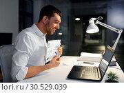 Купить «businessman having video chat at night office», фото № 30529039, снято 25 января 2019 г. (c) Syda Productions / Фотобанк Лори
