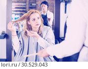 Купить «Young woman is not happy with her hair», фото № 30529043, снято 7 марта 2017 г. (c) Яков Филимонов / Фотобанк Лори