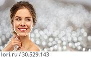 Купить «smiling young woman over grey background», фото № 30529143, снято 20 января 2019 г. (c) Syda Productions / Фотобанк Лори