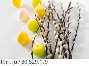 Купить «pussy willow branches and easter egg candles», фото № 30529179, снято 22 марта 2018 г. (c) Syda Productions / Фотобанк Лори
