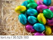 Купить «close up of chocolate easter eggs in straw nest», фото № 30529183, снято 22 марта 2018 г. (c) Syda Productions / Фотобанк Лори