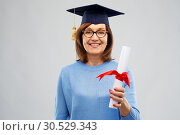 Купить «happy senior graduate student woman with diploma», фото № 30529343, снято 8 февраля 2019 г. (c) Syda Productions / Фотобанк Лори