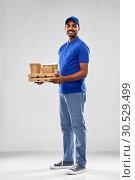 Купить «happy indian delivery man with food and drinks», фото № 30529499, снято 12 января 2019 г. (c) Syda Productions / Фотобанк Лори