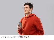 Купить «happy young man drinking soda from tin can», фото № 30529627, снято 3 февраля 2019 г. (c) Syda Productions / Фотобанк Лори