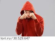 Купить «man in red hoodie fighting with fists or boxing», фото № 30529647, снято 3 февраля 2019 г. (c) Syda Productions / Фотобанк Лори