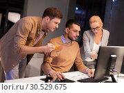 Купить «business team with computer working late at office», фото № 30529675, снято 26 ноября 2017 г. (c) Syda Productions / Фотобанк Лори