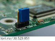 Купить «Computer motherboard circuit. Jumper BIOS config», фото № 30529851, снято 22 января 2010 г. (c) Tryapitsyn Sergiy / Фотобанк Лори