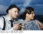Smoking impudent gangster with retro girl. Стоковое фото, фотограф Tryapitsyn Sergiy / Фотобанк Лори