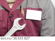 Name tag on uniform and wrench. Стоковое фото, фотограф Tryapitsyn Sergiy / Фотобанк Лори