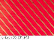Striped red gift paper. Стоковое фото, фотограф Tryapitsyn Sergiy / Фотобанк Лори