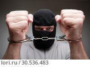 Купить «Angry criminal in handcuffs», фото № 30536483, снято 28 февраля 2011 г. (c) Tryapitsyn Sergiy / Фотобанк Лори