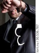 Businessman with unlocked handcuffs. Стоковое фото, фотограф Tryapitsyn Sergiy / Фотобанк Лори
