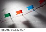 Купить «Pins on sketched red arrow points», фото № 30537007, снято 22 апреля 2011 г. (c) Tryapitsyn Sergiy / Фотобанк Лори