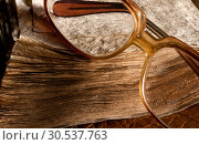 Antique glasses on old weathered book. Стоковое фото, фотограф Tryapitsyn Sergiy / Фотобанк Лори