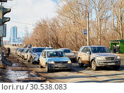 Купить «Kirov, Russia - March 23, 2019: Car on the dirty road in Russia in a spring day. Spring city landscape in a sunny day with blue sky with clouds», фото № 30538083, снято 23 марта 2019 г. (c) Кривошеина Елена Леонидовна / Фотобанк Лори