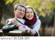 Mature loving couple in spring park. Стоковое фото, фотограф Яков Филимонов / Фотобанк Лори