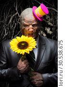 Купить «Sad business monster with sunflower», фото № 30538675, снято 21 марта 2012 г. (c) Tryapitsyn Sergiy / Фотобанк Лори