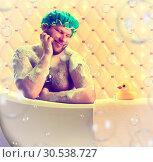 Romantic dreamer taking bath. Стоковое фото, фотограф Tryapitsyn Sergiy / Фотобанк Лори