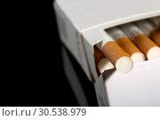 Купить «Cigarettes in pack», фото № 30538979, снято 10 августа 2012 г. (c) Tryapitsyn Sergiy / Фотобанк Лори