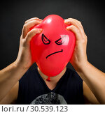 Squeezing angry balloon. Стоковое фото, фотограф Tryapitsyn Sergiy / Фотобанк Лори