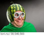 Купить «Funny man with watermelon helmet and googles», фото № 30540583, снято 19 сентября 2013 г. (c) Tryapitsyn Sergiy / Фотобанк Лори