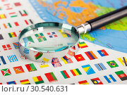 Magnifying glass on the flags. Стоковое фото, фотограф Tryapitsyn Sergiy / Фотобанк Лори