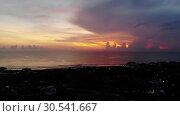Купить «Idyllic drone footage of ocean against cloudy sky during sunset.», видеоролик № 30541667, снято 9 апреля 2019 г. (c) Женя Канашкин / Фотобанк Лори