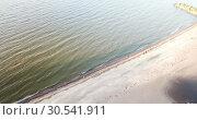 Купить «View from the drone on the sandy beach and the coast of the Gulf of Finland, on the horizon the districts of St. Petersburg», видеоролик № 30541911, снято 9 апреля 2009 г. (c) Куликов Константин / Фотобанк Лори