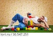 Happy man weared as baby. Стоковое фото, фотограф Tryapitsyn Sergiy / Фотобанк Лори