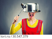 Купить «Crazy housewife with sause pan», фото № 30547379, снято 7 декабря 2013 г. (c) Tryapitsyn Sergiy / Фотобанк Лори