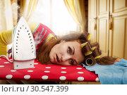Купить «Tired housewife with ironing-board», фото № 30547399, снято 7 декабря 2013 г. (c) Tryapitsyn Sergiy / Фотобанк Лори