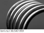 Купить «Aluminum spiral isolated on gray background», фото № 30547959, снято 10 апреля 2014 г. (c) Tryapitsyn Sergiy / Фотобанк Лори