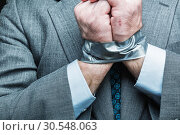 Купить «Businessman with hands covered by masking tape», фото № 30548063, снято 21 апреля 2014 г. (c) Tryapitsyn Sergiy / Фотобанк Лори