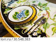 Купить «Plate with a pattern Khokhloma», фото № 30548383, снято 29 мая 2014 г. (c) Tryapitsyn Sergiy / Фотобанк Лори