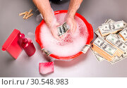 Купить «Human is washing dollars banknotes in foam», фото № 30548983, снято 29 июля 2014 г. (c) Tryapitsyn Sergiy / Фотобанк Лори